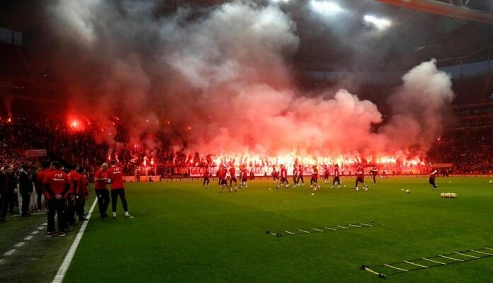 Galatasaray fans prepare for derby as they set off flares during training session