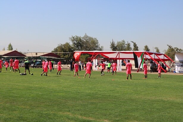 Deportivo Palestino players training on their new pitch.