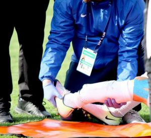 Medical staff assessing Sezer Ozmen's broken foot