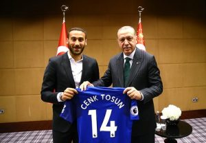 Cenk Tosun gives signed jersey to Erdogan.