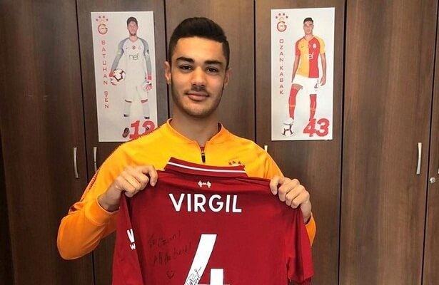 Ozan Kabak receives a signed Virgil van Dijk shirt from the Liverpool star